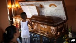 A boy looks at the coffin holding the body of Candido Rios Vazquez, a journalist for the Diario de Acayucan newspaper, who was murdered in Hueyapan de Ocampo in Veracruz state, Mexico, Aug. 23, 2017. Rios reportedly had been threatened repeatedly since 2012 by a former mayor of Hueyapan de Ocampo.