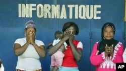 Christian and Muslim supporters of Alassane Ouattara participate in a special Muslim prayer in honor of the civilians killed in three months of post-election violence, following Friday prayers at a mosque in the Treichville neighborhood of Abidjan, Ivory