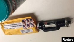 "A package containing a ""live explosive device,"" according to police, received at the Time Warner Center which houses the CNN New York bureau, in New York City, is shown in this handout picture provided Oct. 24, 2018."