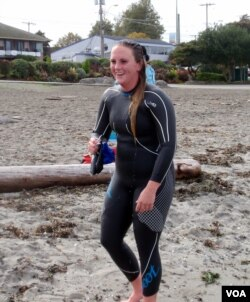Kelly Reynolds of Seattle is seen after her first distance swim in Puget Sound. (VOA / T. Banse)