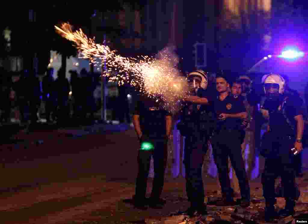 Riot police fire tear gas towards protesters during clashes on Kennedy Street in central Ankara, June 18, 2013.