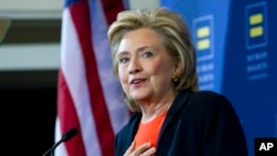 "Democratic presidential candidate Hillary Clinton gestures as she speaks at Human Rights Campaign gathering in Washington, Oct. 3, 2015. Clinton appeared at the late night comedy show ""Saturday Night Live"" on Saturday, appearing in a sketch as a bartender alongside comedian Kate McKinnon, who played the former United States senator and secretary of state."