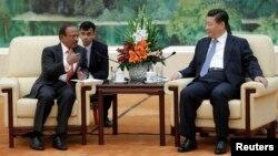 中国主席习近平在北京人民大会堂会见印度国家安全顾问多瓦尔(2014年9月9日)