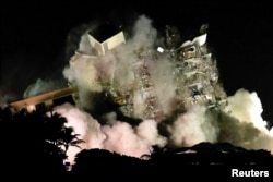 The partially collapsed Champlain Towers South residential building is demolished in Surfside, Florida, U.S., July 4, 2021. Picture taken July 4, 2021.