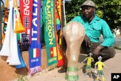 Madziwana sells an assortment of soccer paraphernalia- including scarves, flags and even replicas of the World Cup made from beads and wire