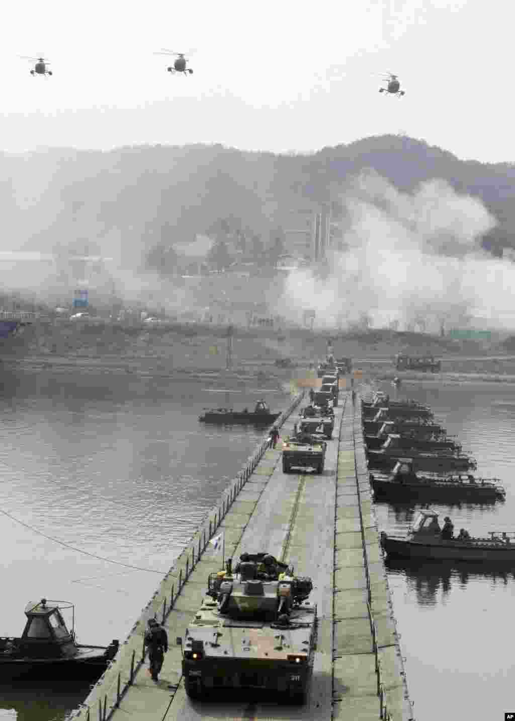 South Korean Army armored vehicles cross a pontoon bridge during an exercise against possible attacks by North Korea near the demilitarized zone in Hwacheon, South Korea, April 1, 2013.
