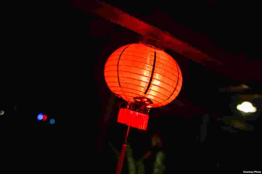 A red lantern hangs on stage, Siem Reap, Cambodia, July 14, 2017. (Photo: Enric Contreras)