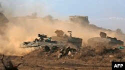 Tank-tank tentara Israel di Dataran Tinggi Golan yang dikuasai Israel di perbatasan dengan Suriah, 12 November 2019.