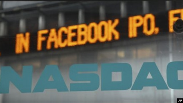 News about the Facebook IPO passes on a billboard outside of NASDAQ in Times Square, New York, May 15, 2012.