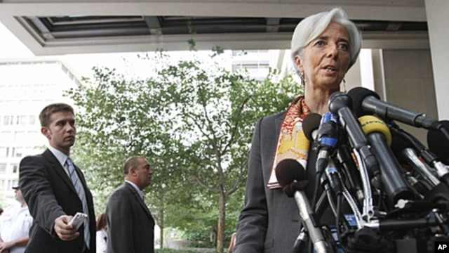 French Finance Minister Christine Lagarde speaks to the media outside the International Monetary Fund in Washington, June 23, 2011.
