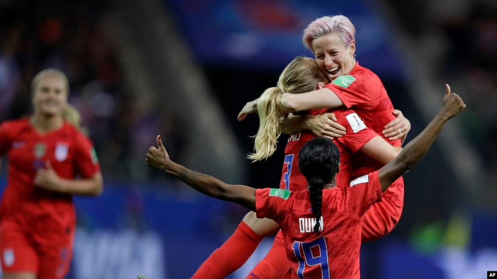 United States' scorer Samantha Mewis lifts her teammate Megan Rapinoe as she celebrates her side's 4rth goal during the Women's World Cup soccer match between United States and Thailand June 11, 2019. (AP Photo/Alessandra Tarantino)
