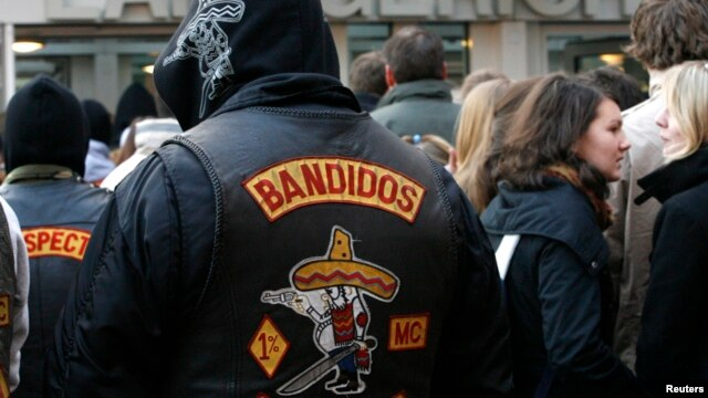 FILE - Members of motorcycle gang 'Bandidos' wait in front the regional court in Muenster.
