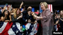 Democratic U.S. presidential candidate Hillary Clinton greets supporters as she arrives to address attendees at her New York presidential primary night rally in the Manhattan borough of New York City, U.S., April 19, 2016.
