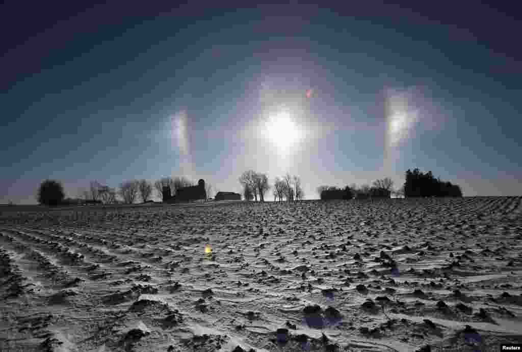 "A ""sun dog"" atmospheric phenomenon appears over a farm in southern Minnesota. Chicago, Minneapolis and other parts of the upper Midwest will have two consecutive days of subzero highs on Monday and Tuesday, according to forecasters."