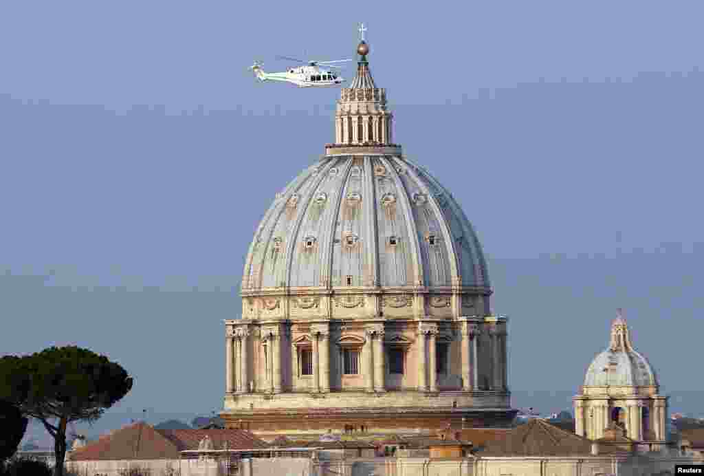 A helicopter carrying Pope Benedict takes off from inside the Vatican on its way to the papal summer residence at Castel Gandolfo, Feb. 28, 2013.