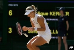 Germany's Angelique Kerber celebrates after winning the women's singles final match against Serena Williams of the United States, at the Wimbledon Tennis Championships, in London, July 14, 2018.