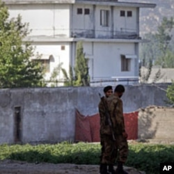 Soldiers keep guard around a compound within which al Qaeda leader Osama bin Laden was killed in Abbottabad May 3, 2011