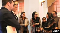 Afghan refugee teacher, Aqeela Asifi, shares her perspective on the Refugee Affected and Hosting Areas Initiative with U.S. Ambassador to Pakistan Richard G. Olson and UNDP Country Director, Marc-André Franche, Aug. 28, 2015. (UNDP Pakistan/Tabinda Siddiqi)