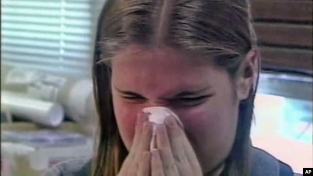 An allergy sufferer sneezes, and scientists say rising average temperatures and elevated levels of carbon dioxide are spurring the growth of many weedy, allergenic plants, and extending the season of suffering for pollen-sensitive people across the countr