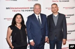 "Co-directors Bonni Cohen, left, and Jon Shenk, right, pose with former U.S. Vice President Al Gore at a special screening of ""An Inconvenient Sequel: Truth To Power"" at The Whitby Hotel in New York, July 17, 2017."