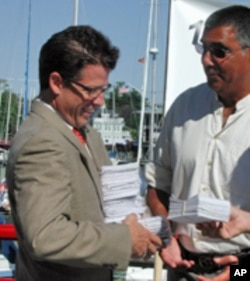 Outside his office in Annapolis, Environmental Protection Agency official Chuck Fox accepts 19,000 postcard petitions from citizens who call for stronger federal action in Bay restoration