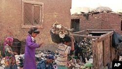 Residents of the Cairo settlement of Manshiet Nasser collect garbage in the streets of the neighborhood. The settlement, populated by Egyptian Christians, is where Cairo, Africa's biggest city, dumps its garbage. Residents then sort it out. They are known
