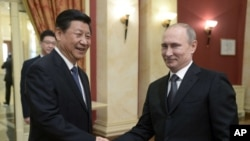 روسیه و چین برای توسعه روابط شان موافقه کردند