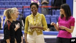 First lady Michelle Obama and Samantha Cameron, wife of British Primer Minister David Cameron, talk with United States Women's National Soccer Team midfielder Lori Ann Lindsey, left, and defender Becky Sauerbrunn as they join with students participating i