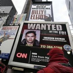 A video display showing suspects wanted by the FBI in New York's Times Sqare