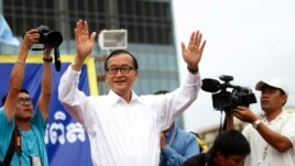 Sam Rainsy, president of the Cambodia National Rescue Party (CNRP), greets his supporters. September 17, 2013.