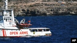 The Open Arms vessel with 107 migrants on board is anchored off the Sicilian vacation and fishing island of Lampedusa, southern Italy, Aug. 19, 2019.