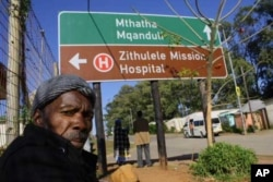 A man waits outside Zithulele Hospital for an appointment with physiotherapist Laura Grobicki