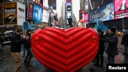 "Drummers perform on ""HeartBeat"" by Stereotank, a Brooklyn-based design studio, which is the 2015 winning Times Square Valentine Heart produced by the Times Square Alliance, in New York City February 9, 2015. The interactive sculpture consisting of a massi"