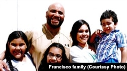 Junior Andres Francisco poses with wife Mirtha, holding their son, and two daughters in this undated photograph. They fear he may be deported from the United States to his native Dominican Republic because of a drug conviction.