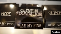 FILE - A Clinton Foundation brooch is seen for sale at the Clinton Museum Store in Little Rock, Arkansas, U.S., April 27, 2015.