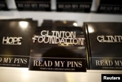 FILE - A Clinton Foundation brooch is seen for sale at the Clinton Museum Store in Little Rock, Arkansas, April 27, 2015.
