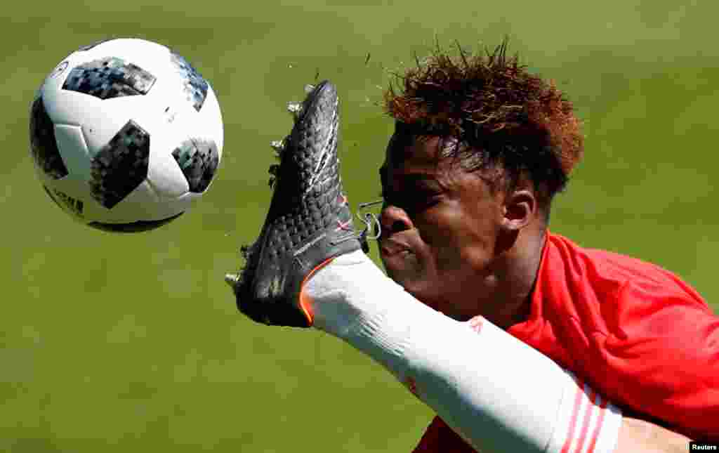 Largie Ramazani vies for a ball during the UEFA European Under-17 Championship Quarter-Final football match between Belgium and Spain at the Banks's Stadium in Walsall, Britain.