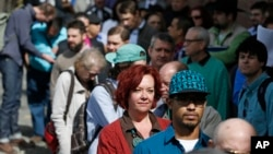 Job seekers line up in the hundreds to attend a marijuana industry job fair hosted by Open Vape, in Downtown Denver, Colorado, March 27, 2014.