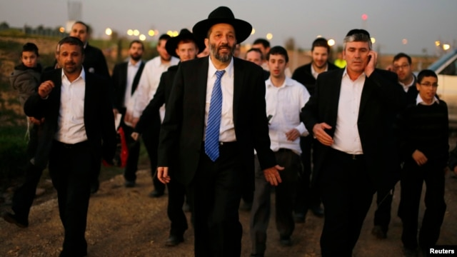 Aryeh Deri (C), leader of the ultra-Orthodox Shas party, attends an annual pilgrimage to the gravesite of Rabbi Yisrael Abuhatzeira, in the southern town of Netivot, Jan. 14, 2013.