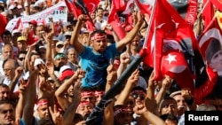Anti-government protesters shout slogans during a demonstration in Istanbul, Turkey, June 23, 2013.