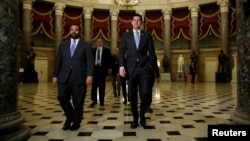 FILE - Speaker of the House Paul Ryan (R-WI), right, walks to the House floor before a vote, on Capitol Hill in Washington, Feb. 9, 2018.