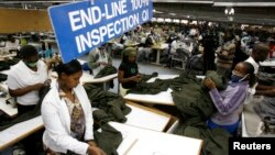 FILE - Kenyan workers prepare clothes for export at the Alltex export processing zone factory in Athi River, near Nairobi.