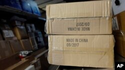 "FILE - Packages labeled ""Made in China"" are loaded on a UPS truck for delivery in New York."