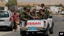 지난 18일 이라크 북부 모술 주변에서 이동 중인 쿠르드 자치정부 페쉬메르가 병사들.