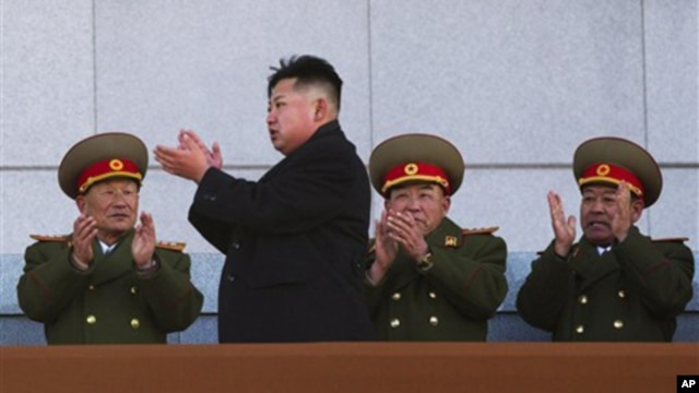 New North Korean leader Kim Jong Un, second from left, applauds as he leaves the stands at Kumsusan Memorial Palace in Pyongyang, Feb. 16, 2012.
