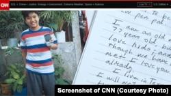 Hình ảnh cậu bé Timothy người Philippines mà cố Tổng thống George W H Bush bảo trợ và một trong những bức thư ông gửi cho cậu bé. (Screenshot of CNN)