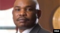 Law professor Makau Mutua writes articles critical of Kenya's president and deputy president in Kenya newspapers