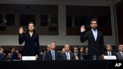 Facebook COO Sheryl Sandberg, left, accompanied by Twitter CEO Jack Dorsey are sworn in before the Senate Intelligence Committee hearing on 'Foreign Influence Operations and Their Use of Social Media Platforms' on Capitol Hill, Sept. 5, 2018, in Washingto