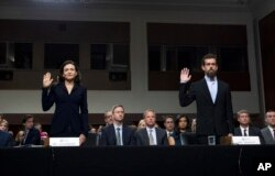 Facebook COO Sheryl Sandberg, left, accompanied by Twitter CEO Jack Dorsey are sworn in before the Senate Intelligence Committee hearing on 'Foreign Influence Operations and Their Use of Social Media Platforms' on Capitol Hill, Sept. 5, 2018, in Washington.