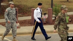 Army Sgt. Bowe Bergdahl, center, leaves a courtroom after a pretrial hearing in Fort Bragg, North Carolina, Nov. 14, 2016. Bergdahl faces a military trial in 2017 on charges of desertion and misbehavior before the enemy after walking off his post in Afghanistan in 2009.